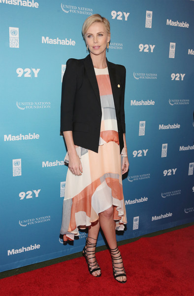 Charlize Theron Strappy Sandals [carpet,clothing,red carpet,fashion,premiere,footwear,flooring,shoulder,event,outerwear,charlize theron,92y,new york city,social good summit]