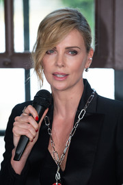 Charlize Theron looked gorgeous wearing this bun with side-swept bangs while receiving the Swarovski Crystal of Hope award.