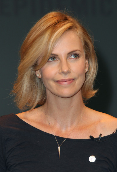 Charlize Theron Bob [report,hair,face,hairstyle,eyebrow,blond,chin,beauty,layered hair,lip,shoulder,charlize theron,unaids new fast track,california,los angeles,unaids launches new fast track report ahead of world aids,ucla,launch,world aids day]