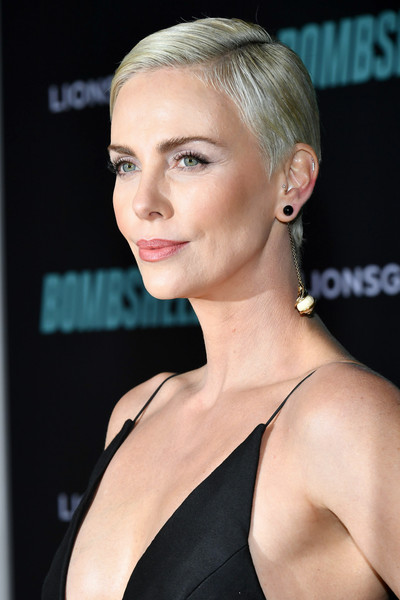 Charlize Theron Short Side Part [bombshell,hair,face,hairstyle,blond,eyebrow,chin,beauty,lip,shoulder,skin,red carpet,charlize theron,california,regency village theatre,special screening of liongate,westwood,screening,charlize theron,bombshell,pixie cut,fashion,hairstyle,critics choice movie awards,actor,bowl cut,short hair,celebrity]