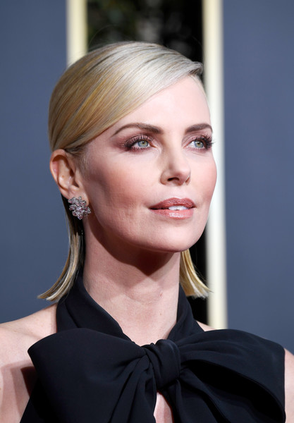 Charlize Theron Side Parted Straight Cut [hair,face,hairstyle,blond,eyebrow,chin,beauty,lip,skin,fashion,arrivals,charlize theron,the beverly hilton hotel,beverly hills,california,golden globe awards]