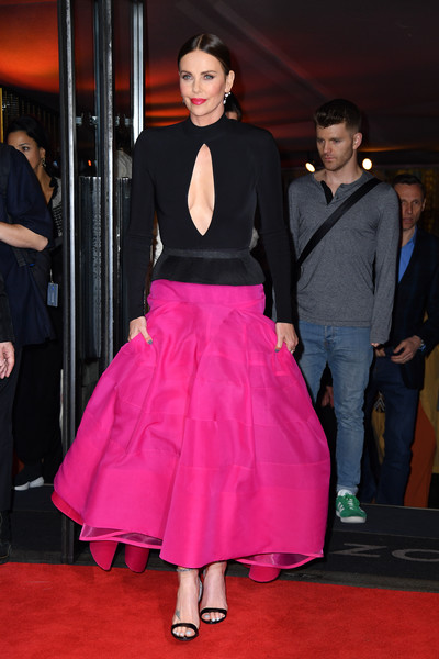 Charlize Theron Peplum Top [long shot special screening,red carpet,clothing,carpet,pink,fashion,flooring,dress,event,premiere,haute couture,red carpet arrivals,charlize theron,england,london,screening,curzon cinema mayfair]