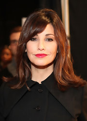 Gina Gershon attended the Charlotte Ronson fashion show wearing her hair in a flip with side-swept bangs.
