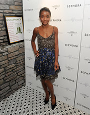 Genevieve Jones looked pretty in a brown and blue floral print sundress at the Charlotte Ronson and Sephora dinner.