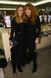 Olivia Palermo went for subdued sophistication in a long-sleeve black dress during the VIP Beauty launch.