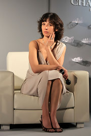 Sophie Marceau's peep toe pumps fit her fashionable frock perfectly.