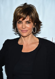 A calculated mix of blonde, honey, and caramel highlights brought beautiful radiance to Lisa Rinna's locks.