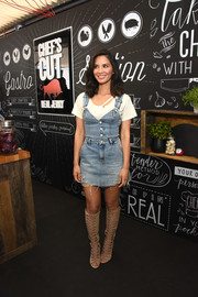 Olivia Munn tied her look together with a pair of knee-high lace-up boots.