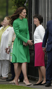 Kate Middleton dressed up in a green coat dress by Catherine Walker for the Chelsea Flower Show.
