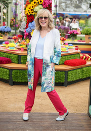 Twiggy was appropriately dressed in a landscape-print coat for the Chelsea Flower Show.