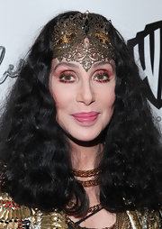 Cher looked exotic wearing a filigree headband at the Marquee Club in NYC.