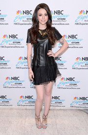 Cher Lloyd donned an edgy-meets-girly black leather-chiffon dress for her CD signing.