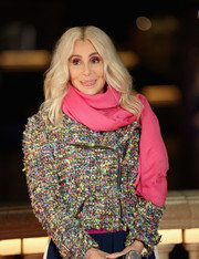Cher paired a hot-pink scarf with a multicolored tweed jacket for a vibrant look during the unveiling of the new Fountains of Bellagio show.