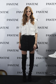 Chiara Ferragni paired her shirt with a black button-front mini skirt.