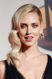 Chiara Ferragni channeled Old Hollywood with her side-swept waves at the Venice Film Festival screening of 'Chiara Ferragni — Unposted.'