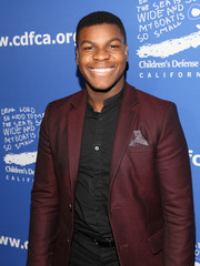 John Boyega was all smiles in this maroon-colored sport coat.
