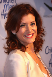 Kate Walsh showed off her fiery red curls while hitting a benefit in LA.