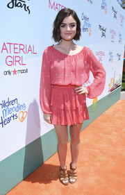 Lucy Hale completed her girly outfit with a pair of brown gladiator heels.
