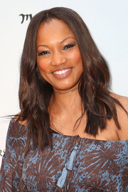Garcelle Beauvais teamed a center-parted wavy 'do with a printed off-the-shoulder dress for a boho vibe at the Empathy Rocks event.