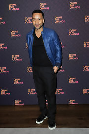 John Legend sported an electric blue bomber jacket while making an appearance at 'The Sound of Change Live.'