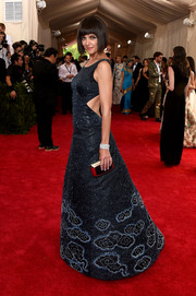 Katie Holmes was all about whimsical glamour at the Met Gala in a Zac Posen cutout gown that looked like a star-filled night sky.