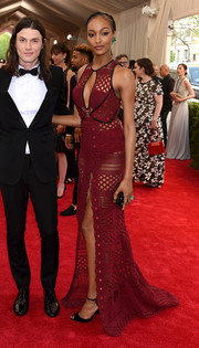 Jourdan Dunn looked majorly seductive at the Met Gala in a perforated burgundy Burberry gown with a keyhole neckline and a high front slit.