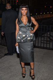 June Ambrose made a stylish appearance at a Met Gala after-party wearing a low-cut gray peplum dress.