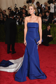 Ivanka Trump went for classic glamour at the Met Gala in a royal-blue and white strapless gown with a flowing train.
