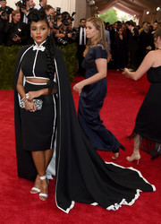 For her shoes, Janelle Monae chose simple white ankle-cuff sandals by Nicholas Kirkwood.