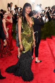 One of the ladies rocking the sheer look during the Met Gala, Naomi Campbell chose a green and black Burberry gown with a plunging neckline, multiple peekaboo accents, and a feathered hem.