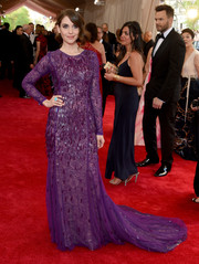 Alison Brie opted for an embellished purple Prabal Gurung gown with a lacy underlay for her Met Gala look.
