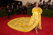 Rihanna owned the Met Gala in her regal canary yellow robe gown with fur trim and heavy embroidery.