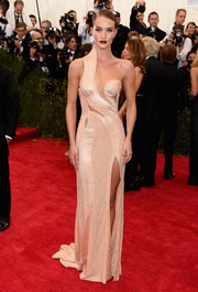 Rosie Huntington-Whiteley was a vision in a daring peach cutout dress with a thigh-high slit at the Met Gala.
