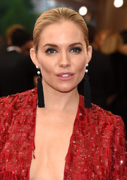 Sienna Miller finished off her look with a pair of custom black tassel earrings by Jacob & Co.