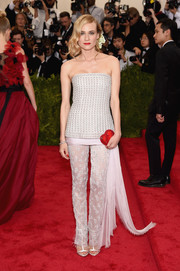A Judith Leiber heart-shaped clutch added a playful touch to Diane Kruger's look.