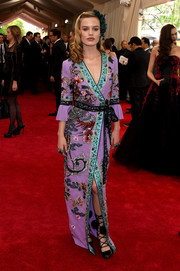 Georgia May Jagger totally got into an Oriental mood in a bird and flower-embroidered wrap gown by Gucci for the Met Gala.