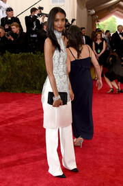 Liya Kebede accessorized her outfit with a simple black satin clutch.