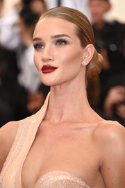 Rosie Huntington-Whiteley looked like a goddess with her elegant bun and sexy one-shoulder dress at the Met Gala.