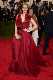 Poppy Delevingne was all abloom at the Met Gala in a red and black Marchesa gown with a flower-appliqued bodice.