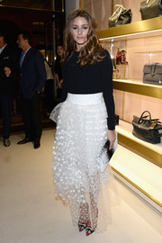 Olivia Palermo styled her simple black top with a flouncy white polka-dot skirt during the 'Chloe Attitudes' book launch.