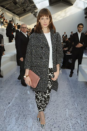 Elettra Wiedemann mixed patterns at the Chloe runway show in Paris where she wore a gray tweed coat with black and white print pants.