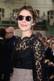 Ulyana Sergeenko topped off her ensemble with a pair of round shades.