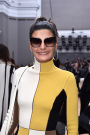 Giovanna Battaglia looked oh-so-chic in her oversized cateye sunnies while attending the Chloe fashion show.