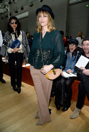 Marie-Josee Croze completed her outfit with a pair of nude wide-leg slacks.