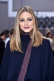 Olivia Palermo framed her pretty face with this sleek center-parted 'do for the Chloe fashion show.