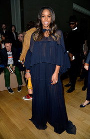 Kelly Rowland matched her blouse with an equally voluminous maxi skirt.