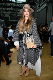 An oversized suede clutch with a snakeskin flap completed Kristina Bazan's eclectic ensemble.