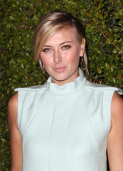 Maria Sharapova finished off her look with a messy-chic updo when she attended the Chloe LA fashion show and dinner.