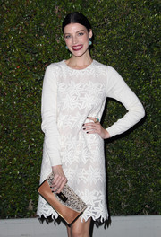 Jessica Pare accessorized with a stylish tan Chloe envelope clutch featuring a studded flap during the label's LA fashion show and dinner.