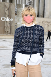 Maisie Williams accessorized with a trio of gold bracelets at the Chloe Spring 2021 show.